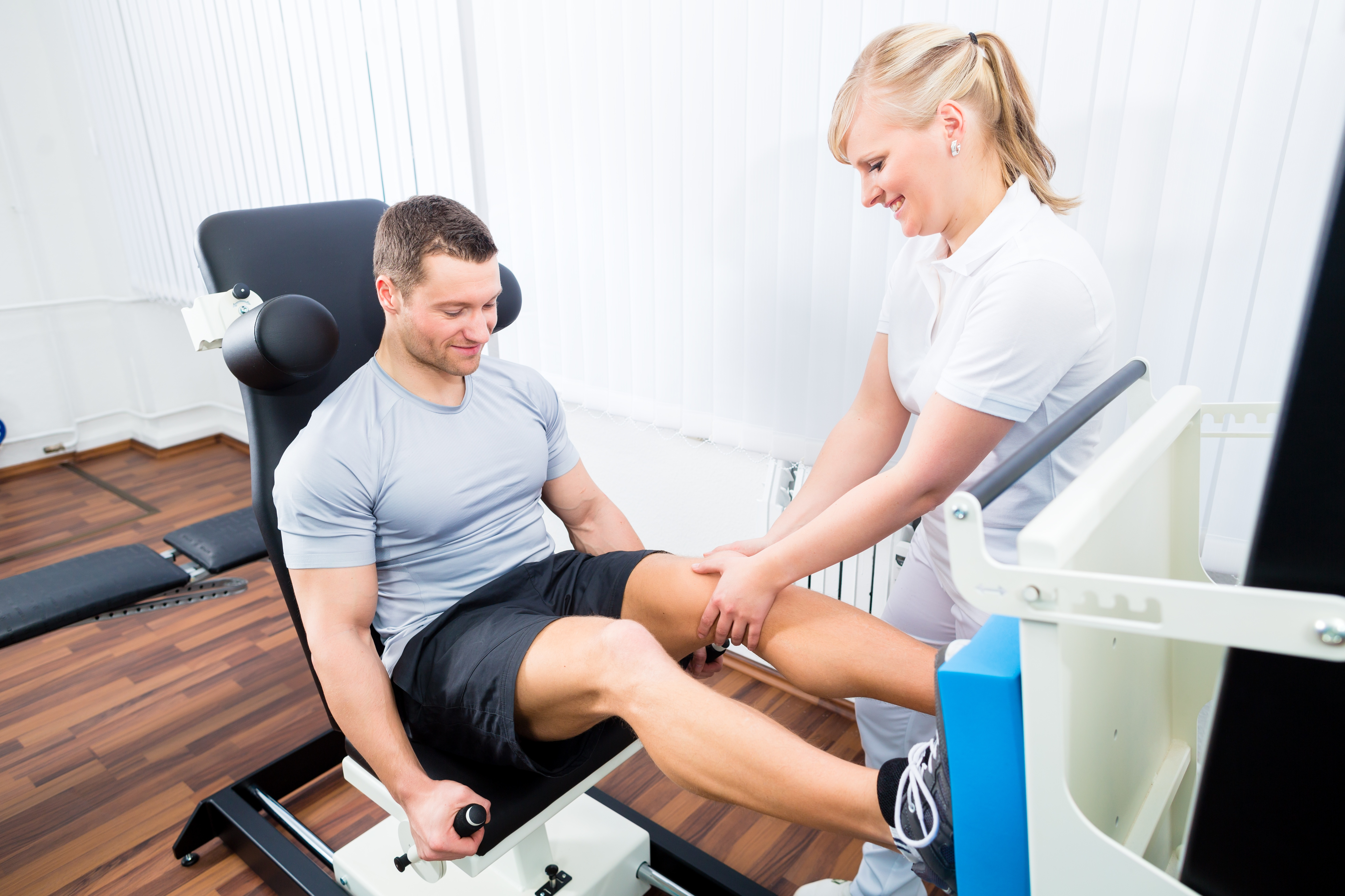 Physical-Therapist-Assistant-Helping-Athlete.jpg