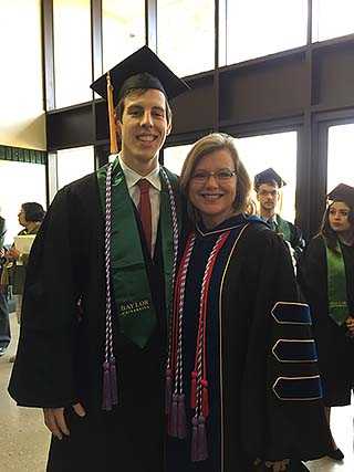 Beth Hultquist poses for a photo with one of her Baylor nursing students at graduation.