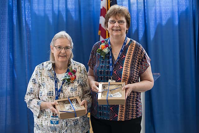 Tem Adair and Bev Sedlacek celebrate their retirement after a combined 39 years of service to Nebraska Methodist College.